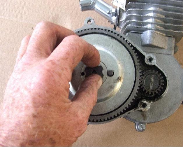 Motorized bicycle clutch adjustment